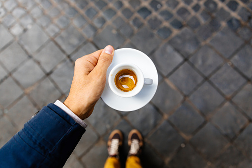 Man holding cup of espresso coffee, personal perspective view - gettyimageskorea