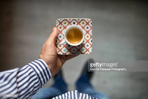man holding cup of espresso coffee - tourism stock pictures, royalty-free photos & images