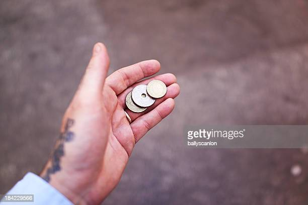 Man holding Danish krone in hand