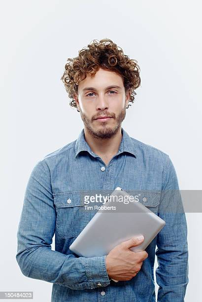 Man holding digital tablet.