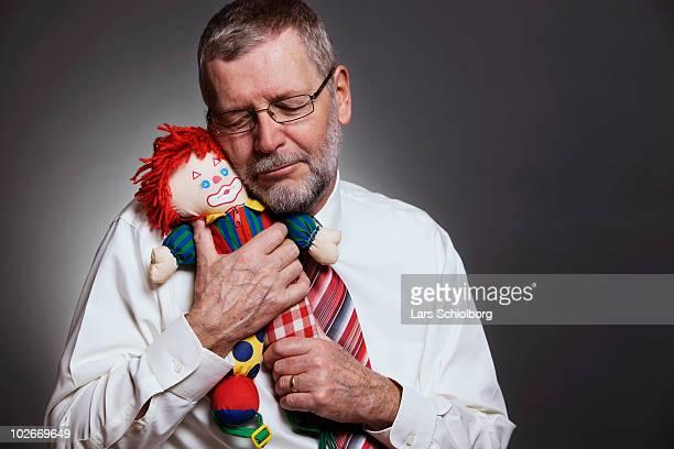 Man holding doll