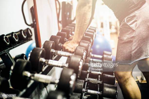 Man holding dumbbell in gym