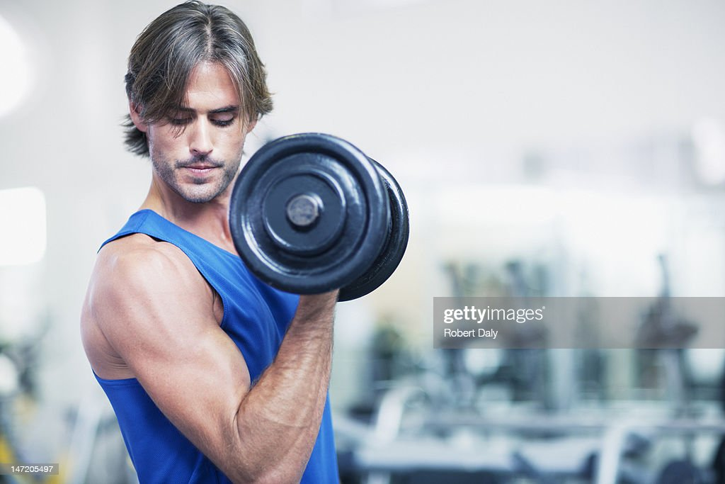 Man holding dumbbell : Stock Photo