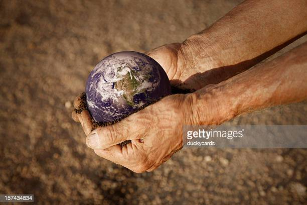 Man Holding Earth in Hands