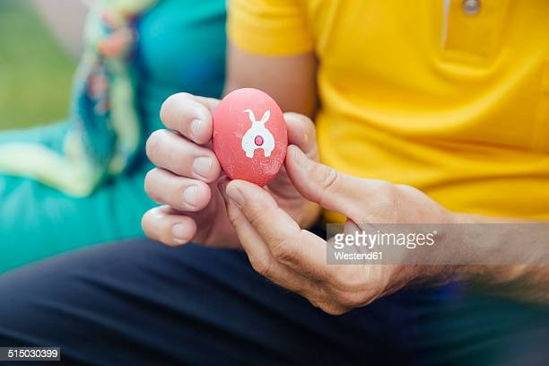 man holding easter egg, close-up - easter bunny man stock pictures, royalty-free photos & images