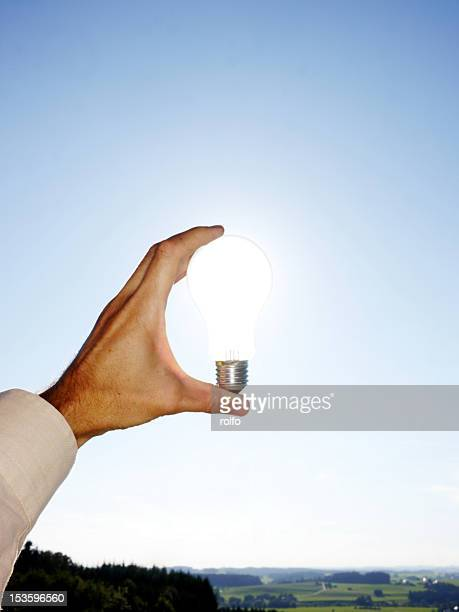 Man holding electric bulb
