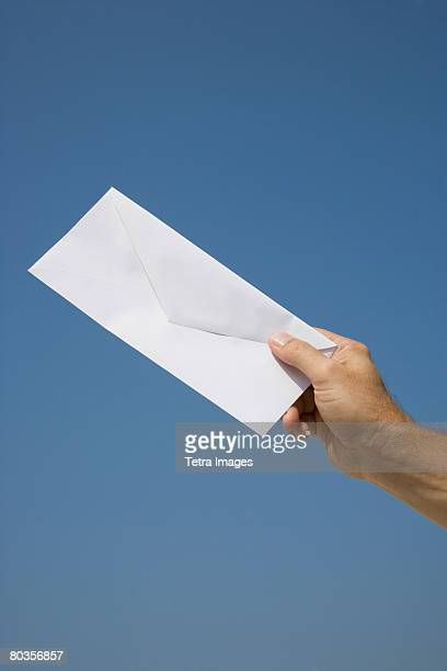 Man holding envelope