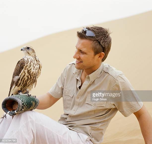 man holding falcon - hugh sitton stock-fotos und bilder