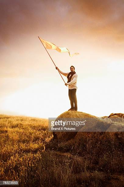 Man holding flag in field
