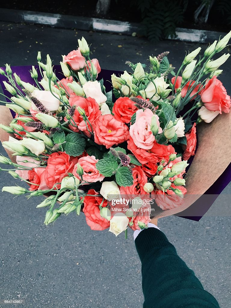 Fantastic flower bouquet for man photos images for wedding gown man holding flower bouquet stock photo getty images izmirmasajfo Image collections