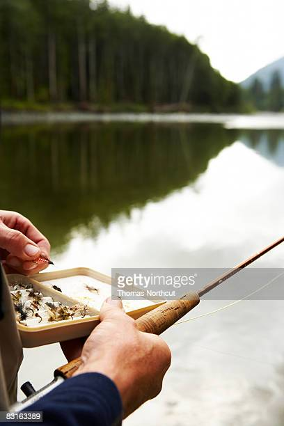 Man holding fly fishing lures