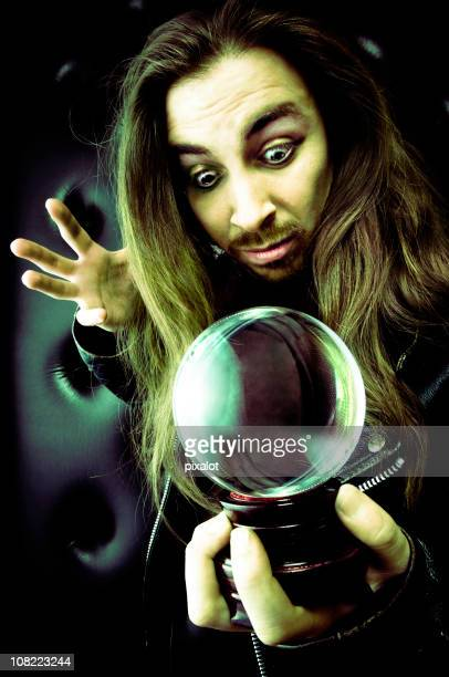 Man Holding Fortune Ball