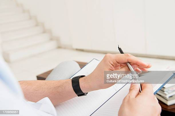 man holding fountain pen and notebook - 万年筆 ストックフォトと画像