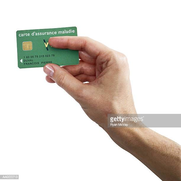 Man Holding French Social Security Card