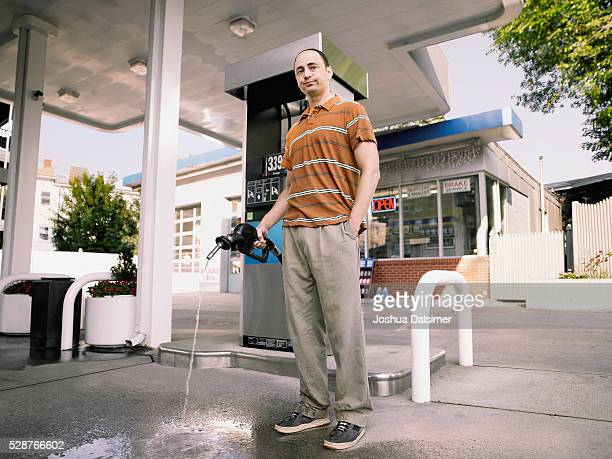 Man holding fuel pump