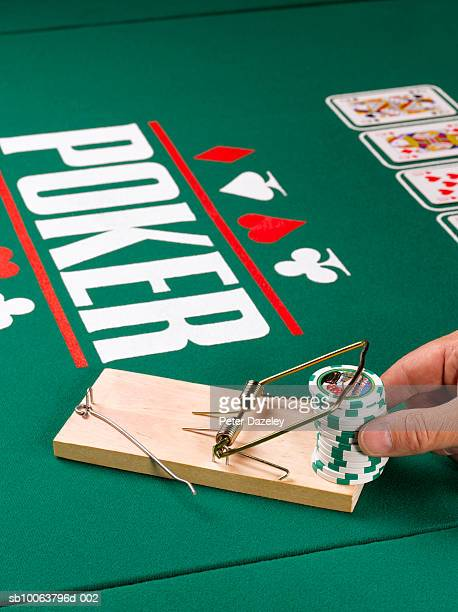 man holding gambling chips in mouse trap and cards on poker table, elevated view - gambling table stock pictures, royalty-free photos & images