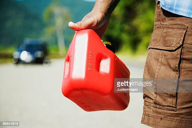 Man holding gas can