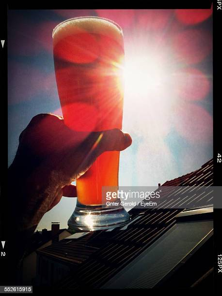 Man Holding Glass Of Beer In Sunlight