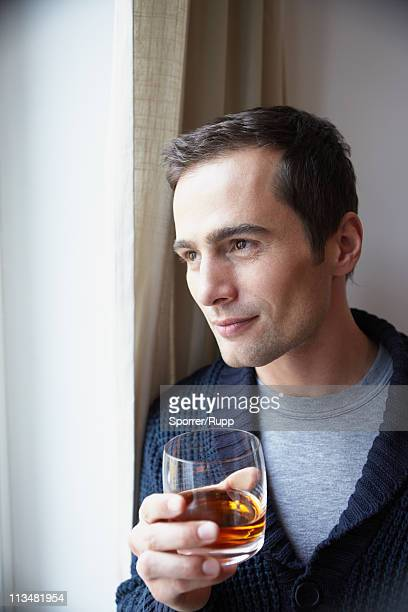 Man holding glass of whiskey