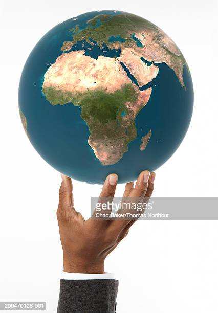 man holding globe with africa prominent (digital composite) - world at your fingertips stock pictures, royalty-free photos & images