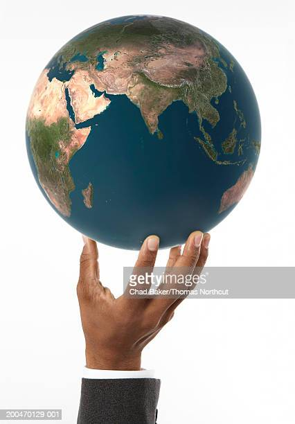 Man holding globe with Asia, Middle East and Africa prominent