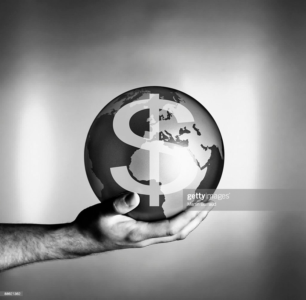 Man holding globe with dollar symbol : Bildbanksbilder