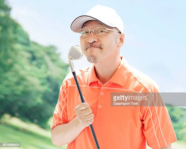Man Holding Golf Club