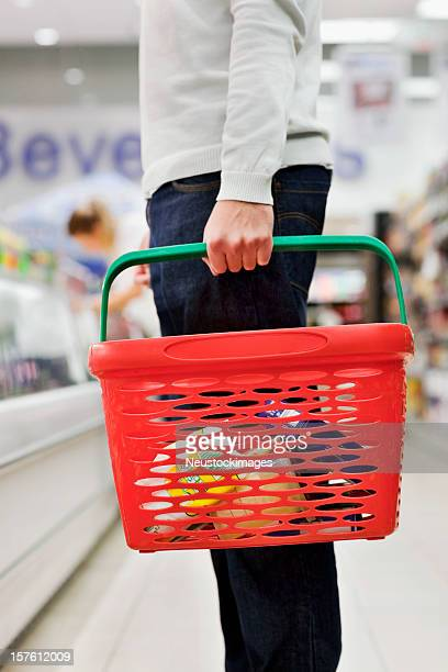 Man Holding Grocery Basket