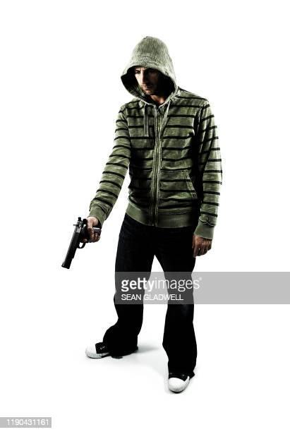 man holding gun - gun stock pictures, royalty-free photos & images