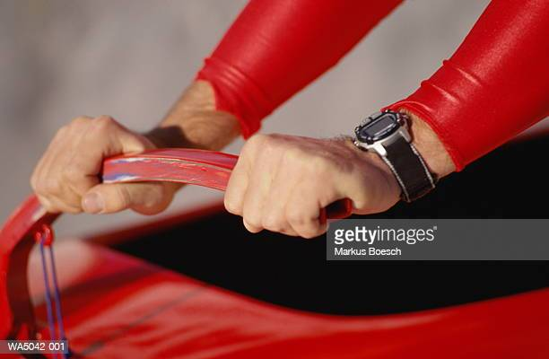 Man holding handle of bobsleigh, close-up