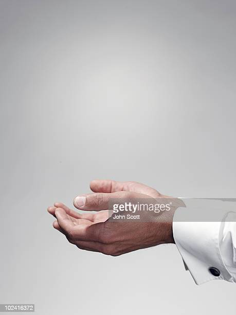 Man holding hands out, close-up of hands