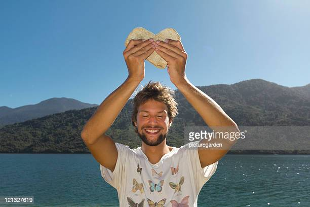 Man Holding Heart Shaped Rock