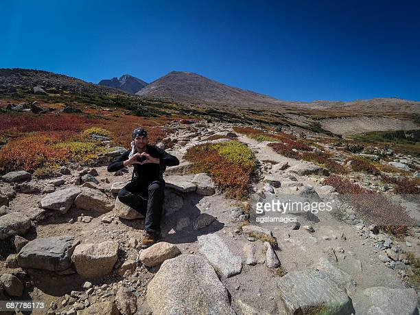 man holding his hands in a heart shape, longs peak, colorado, america, usa - front range mountain range stock pictures, royalty-free photos & images