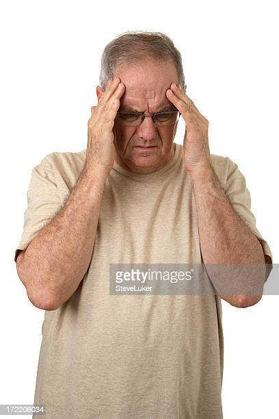 A man holding his head as if he is suffering a big headache