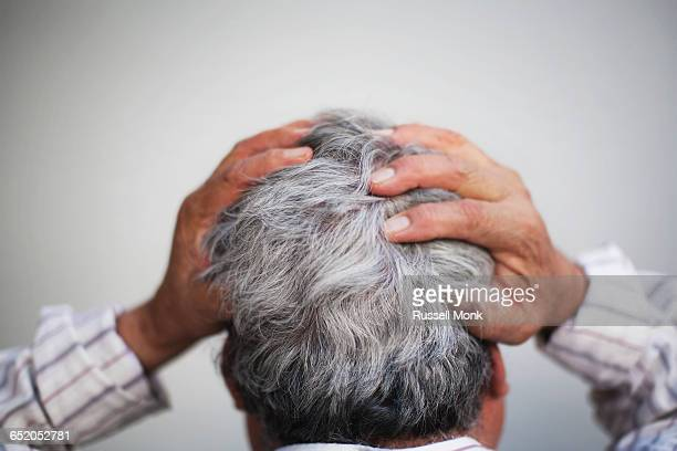 A man holding his head in frustration