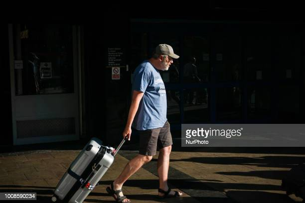 A man holding his luggage during a warm day in London July 26 2018 According to the Met Office July is likely to be the hottest month since record...