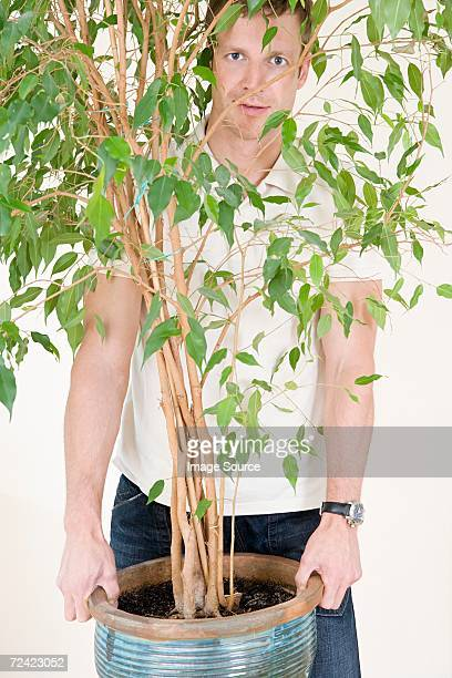 Man holding houseplant