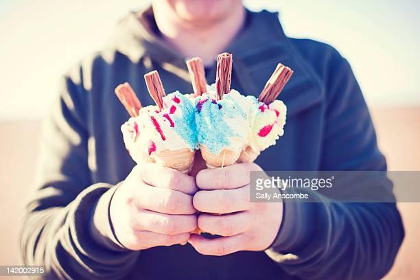 Man holding ice cream cones