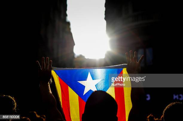 A man holding Independentist flags in front the police the day after the Catalonia independence referendum declared ilegal by the Spanish government...