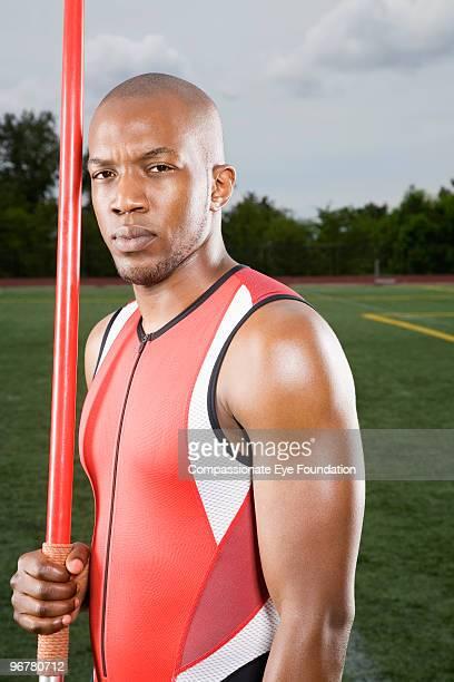 Man holding javelin, portrait