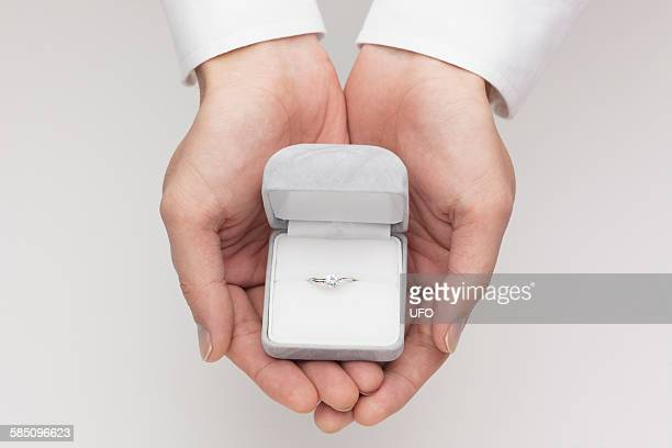 man holding jewelry - engagement ring box stock photos and pictures