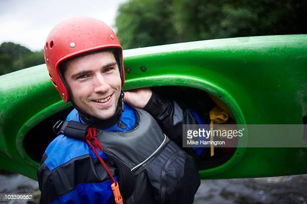 Man holding kayak
