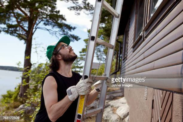 Man holding ladder