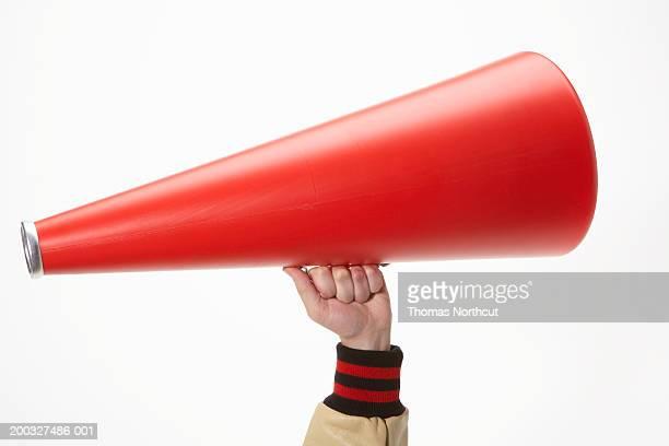 Man holding megaphone, close-up of hand