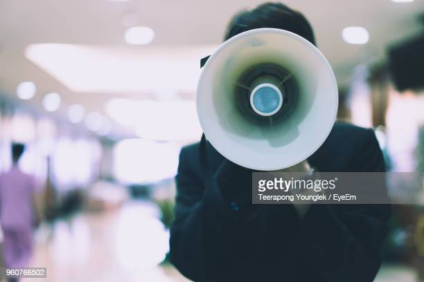 man holding megaphone - megaphone stock pictures, royalty-free photos & images
