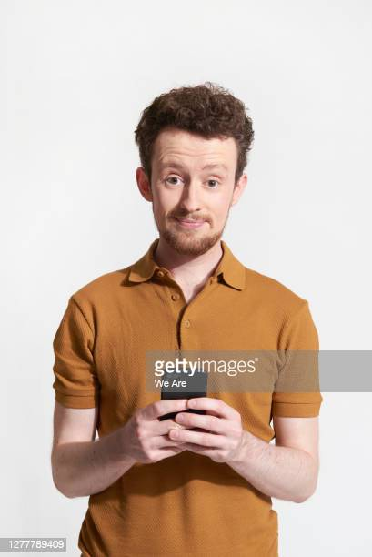 man holding mobile phone - disappointment stock pictures, royalty-free photos & images