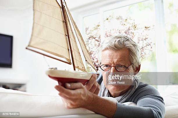man holding model sailboat - model kit stock pictures, royalty-free photos & images