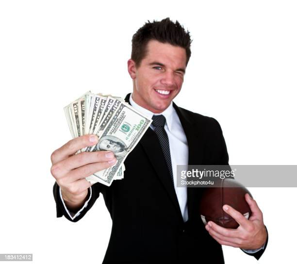Man holding money and football