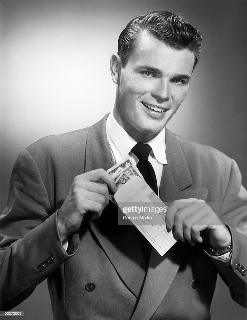 Man holding money and pay voucher : Stock Photo