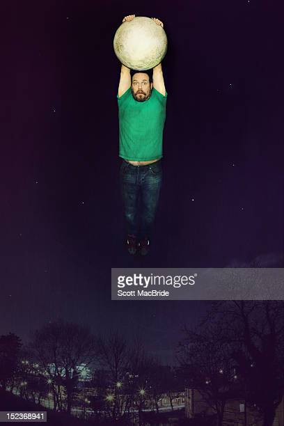 man holding moon - scott macbride stock pictures, royalty-free photos & images